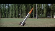 1970s WS Small rocket fired from football field