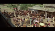 1970s WS HA TU Western town street activity, group of horse riders leaving town