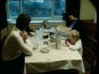 1980s Blunkett sitting eating breakfast with family Blunkett from house with guide dog