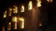 1980s WS LA Flames jumping out of windows of large apartment building