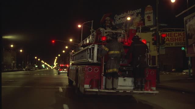 1980s WS POV Following fire trucks through streets of Chicago / Chicago, Illinois, USA