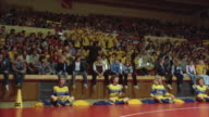 1980s WS High school gymnasium wrestling match. Crowd and cheerleaders.
