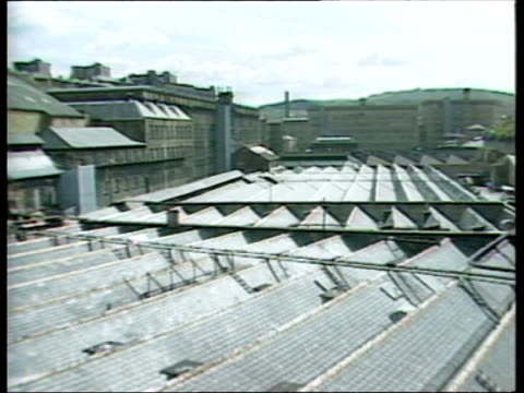part 2 T09098706 991987 CITIES Yorkshire Halifax old pic of Halifax industry DISSOLVES TO Halifax today people traffic in town centre 'Piece Hall'...