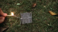 1980s CU HA String of firecrackers exploding on ground