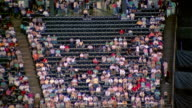 1980s time lapse wide shot people filling up stands at basketball arena prior to game / Houston