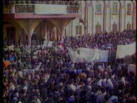 1Jan1991 MONTAGE Protestors in Iran march and demonstrate Saddam Hussein and others watch from balcony above / Iraq
