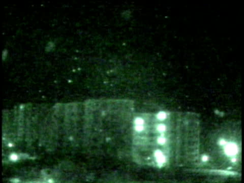 1Jan1991 WS Night vision view of bombs rockets exploding in the sky above buildings / Iraq