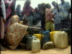 1Oct1998 WS LA Women and kids gathered around central water tap in village / Mogadishu Benadir Somalia