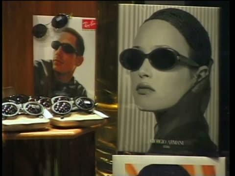 1st April 2000 CU ZO WS Posters and sunglasses on window display / Tehran, Iran