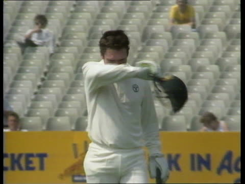 England v Australia a ENGLAND Leeds Headingley CMS Allan Border walking off pitch takes off protective headgear and wipes sweat from brow CMS Border...