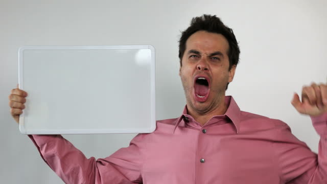 1.\tCharismatic Sales Guy Holding White Board, Rock ON!