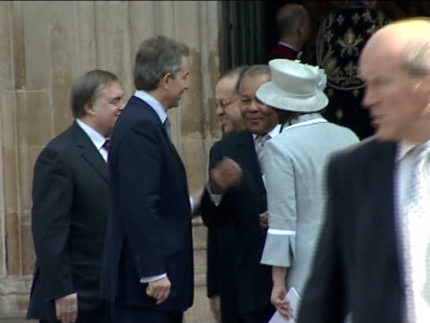 200th Anniversary of abolition of slavery Westminster Abbey service protestor Tony Blair MP out of Abbey with Cherie Blair John Prescott MP and his...