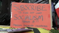 20Mar2010 CU Sign that says Subscribe to find out what Socialism Really is Freedom Socialist Newspaper / Washington DC USA / AUDIO
