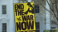 20Mar2010 CU Signs in front of White House which read End the War Now and We Need Jobs and Schools Not War / Washington DC USA / AUDIO