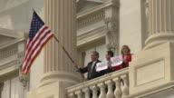 21Mar2010 WS LA Congress people hold signs saying No and large American Flag / Washington DC USA / AUDIO
