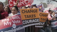 21Mar2010 MS Crowd of people holding signs saying Change Takes Courage and My Faith My Vote for Immigration Reform / Washington DC USA / AUDIO
