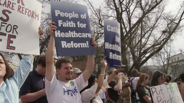21Mar2010 MS People holding signs in support of health care reform / Washington DC USA / AUDIO