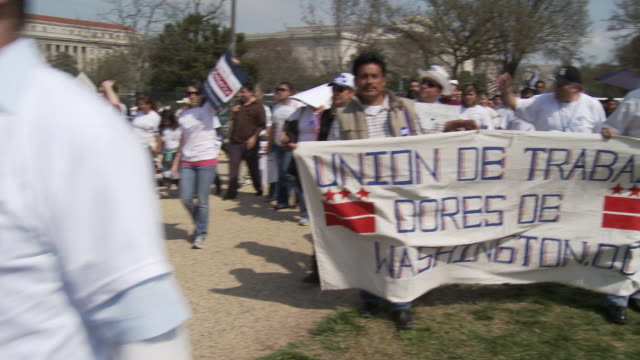 21Mar2010 WS People march holding signs saying Immigration Reform for America / Washington DC USA / AUDIO