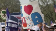21Mar2010 CU Protestors holding signs reading I love America and Reform Immigration for America / Washington DC USA / AUDIO