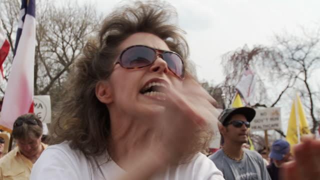 21Mar2010 CU Woman emotionally slams her fist and chants Kill The Bill / Washington DC USA / AUDIO