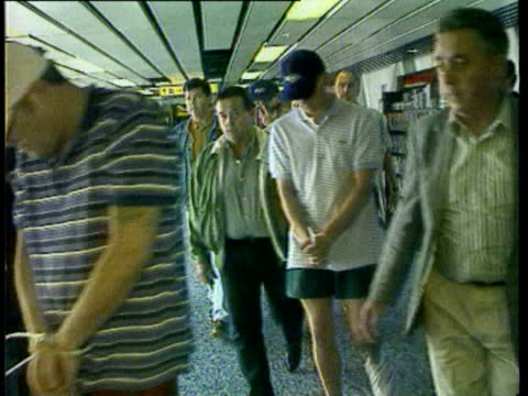 22Jun1998 MONTAGE Deported fans arriving at Heathrow fans and police England fans watching game in bar face painting / AUDIO