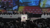 22Mar2010 WS ZI Secretary of State Hillary Clinton strides on stage at Washington Convention Center to give speech before AIPAC / Washington DC