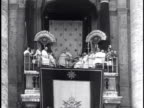 260th BISHOP OF ROME CORONATION HUGE crowd in St Peter's Square Pope Pius XII on loggia w/ others male placing Papal Tiara Crowd Catholics waving...