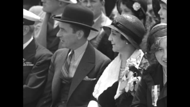 2shot New York City Mayor Jimmy Walker and Mrs Floyd Bennett seated together enjoy the festivities at the opening ceremony for Floyd Bennett Field in...