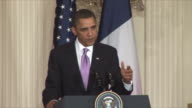 30Mar2010 MS US President Barack Obama answers reporters questions on Iran at press conference during Sarkozy's visit / Washington DC