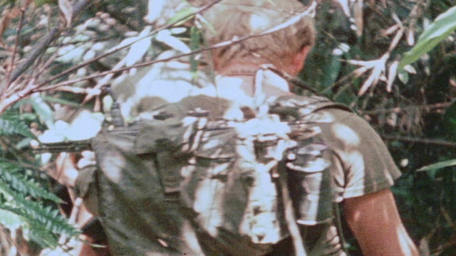 MONTAGE 327th Infantry Regiment soldiers patrolling jungle firing M203 grenade launcher / Vietnam