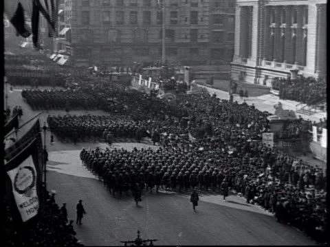 WS 369th Infantry Regiment marching up 5th Ave past 42nd St Library in the WWI victory parade / New York City New York United States