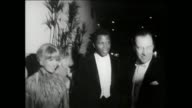 37th Annual Academy Awards OUTSIDE Cars leaving Santa Monica Civic Auditorium exterior OSCAR PARTY Judy Garland exits the auditorium Ginger Rogers...