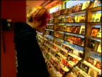 3Apr1997 MONTAGE Interior of Tower Records Store Man listening to CD w/headphones Teenagers looking through Hip Hop / Rap CD titles on racks / USA