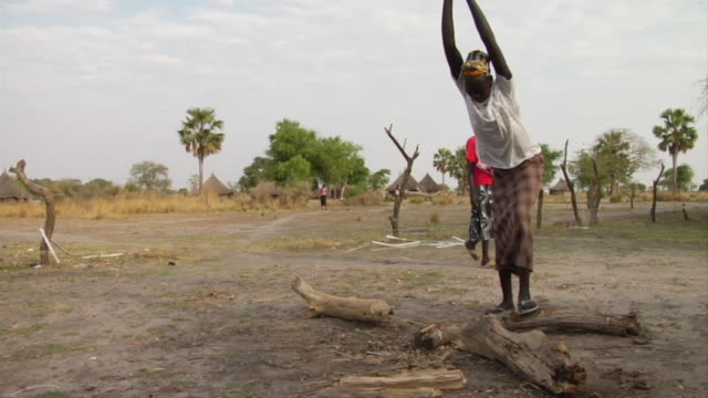 3rd March 2009 SLO MO WS Woman chopping wood with axe / Duk Payuel Jonglei Sudan