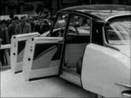 Paris EXT General views exterior of exhibition hall / High angle view cars and crowds in exhibition hall / High angle view Pegaso display / Citroen...
