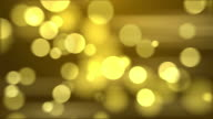4k Abstract Gold Color Bokeh Background. Seamless Loop
