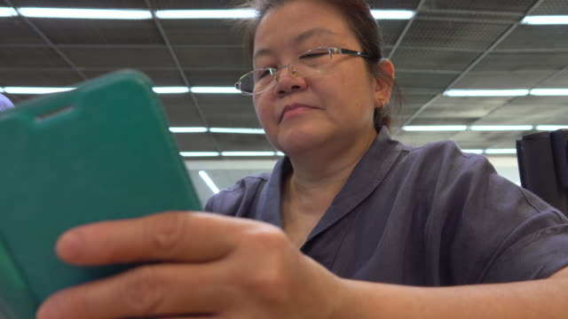 4k: Asian old woman using a smart phone