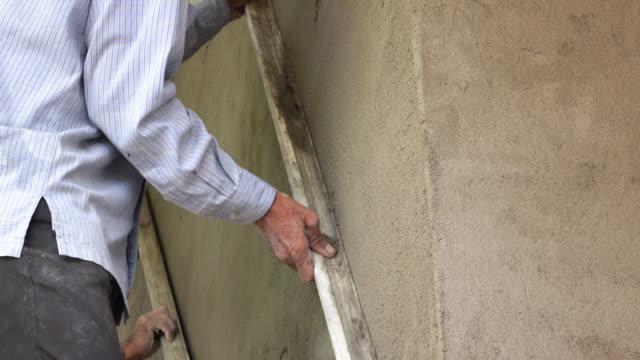 4k, construction worker plaster cement wall