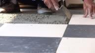 4k, construction worker tiling ceramic tiles floor