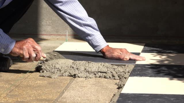 4k, construction worker tiling floor