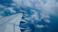 4k footage Aircraft wing flying through the clouds