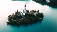 4k helicopter view of the bled lake in slovenia