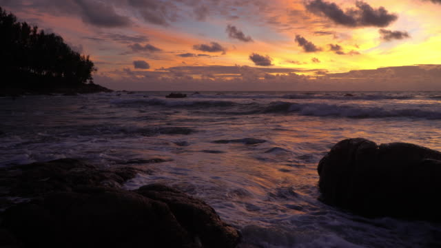 4k of Sea beach and stone with sunset.