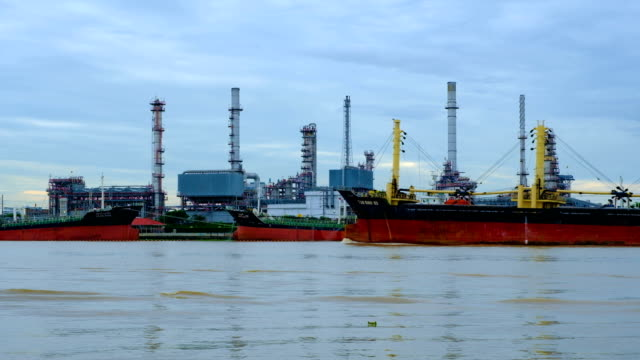 4k Petrochemical industry - Oil refinery with river in Thailand