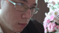 4k: salary man watching phone screen reflection in eyeglasses