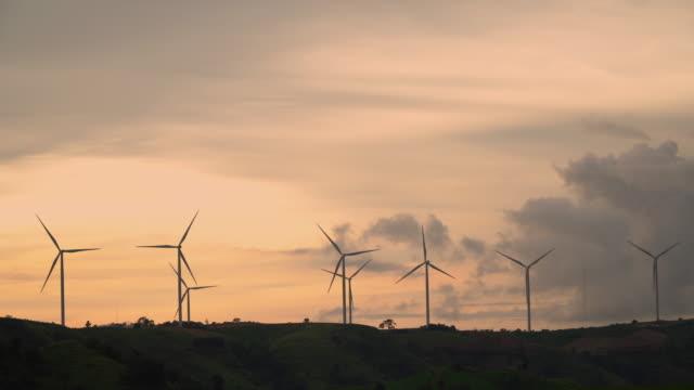 4k Sunset of Farm of Wind Turbine for Alternative Energy.
