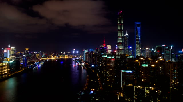 4k time lapse by drone: aerial view of shanghai huangpu river and bund buildings