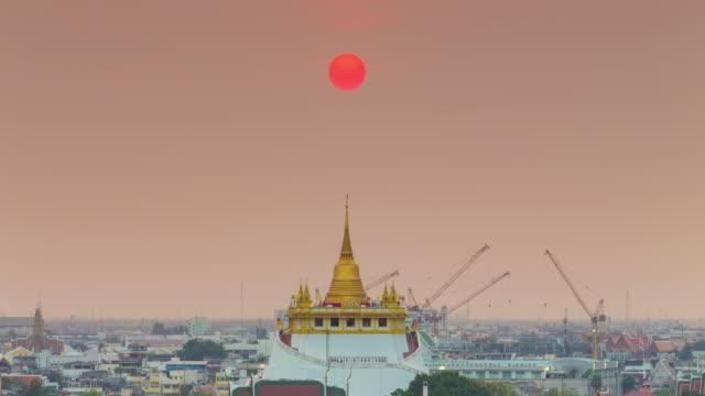 4k Time lapse : Sunset golden temple in center city of Bangkok Thailand