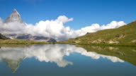 4k Time-lapse : Matterhorn reflected in an alpine lake, Switzerland