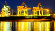 4k timelapse of Cargo ship in the harbor at sunrise